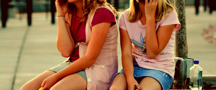 Free Train Station Girls Talking on Cell Phones Creative Commons