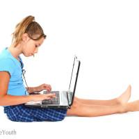 Innocent girl on laptop